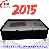 Quality co2 320 Moshi tongli 40w Laser engraving machine for kinds of materials for sale