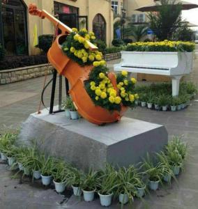 Quality Beautiful Fiberglass Resin Elegant Violoncello Statue For Outdoor School Decoration for sale