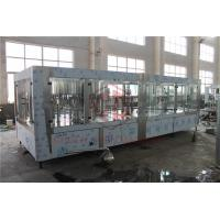China Gravity Plastic Bottle Filling Machine With Shrink Wrapping Equipment  4 in 1 on sale
