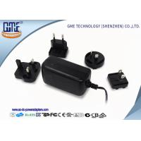 Quality EU / US / BS / AU Prong Interchangeable 12V 2A Universal Ac Dc Adapter for sale