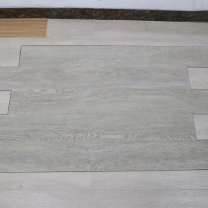 Quality non deformation wood grain uv coating embossed PVC vinyl flooring planks for sale
