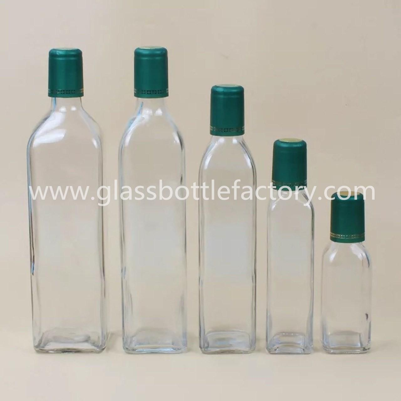 China 100ml,250ml,500ml,750ml,1000ml Clear Square Olive Oil Glass Bottles With Green Caps on sale