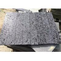 China Hainan Black Travertine Natural Stone Tile / Black Lava Stone Tiles Cut - To - Size for sale