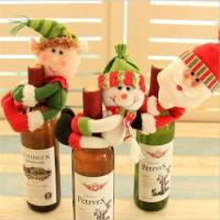 christmas elf doll with wine bottles