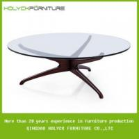 China modern round glass coffee table with wood base on sale